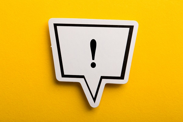 Exclamation Mark Speech Bubble Isolated On Yellow
